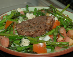 Steak on a bed of Roasted Asparagus with Tomato and Mozzarella
